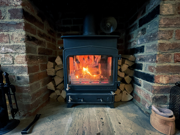 Is a log burning stove an adequate heating source for a house with no central heating
